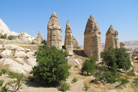 Love valley in Goreme village, Turkey. Rural Cappadocia landscape. Stone houses in Goreme, Cappadocia. Countryside lifestyle.