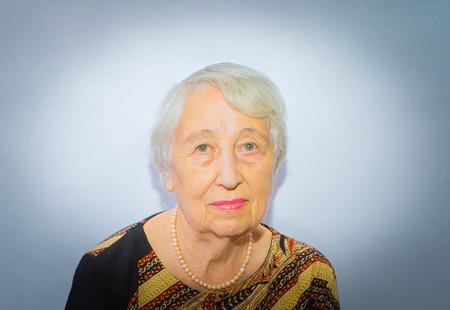 Old woman face portrait, aging process concept