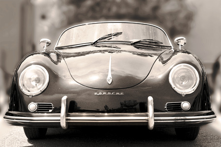 NICE, FRANCE - JUNE 3, 2015: Porsche- luxury vintage sports car at the city street. Retro  style - sepia