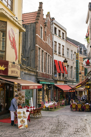 BRUSSELS - APRIL 21, 2016: Colorful narrow street Rue des Bouchers famous for its many cafes and restaurants serving a variety of local and international cuisine. Known as the belly of Brussels