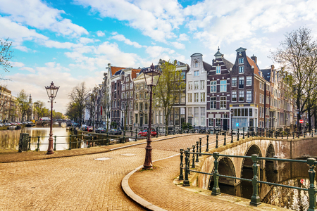 Traditional dutch old houses and bridges on canals in Amsterdam,  Netherlands