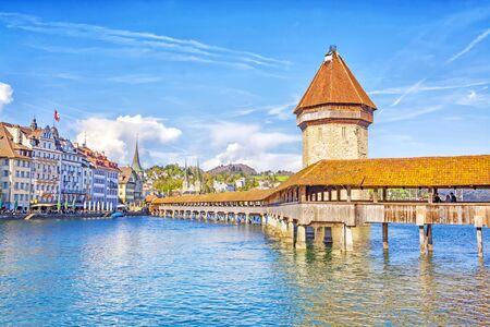 Foto de Ancient covered wooden Chapel Bridge Kapellbrucke and Water Tower Wasserturm in the historic center of Lucerne at sunset, Switzerland - Imagen libre de derechos