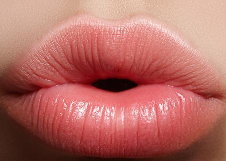 Foto de Close-up perfect natural lip makeup beautiful female mouth. Plump sexy full lips. Macro photo face detail. Perfect clean skin, fresh lip make-up. Beautiful spa tender lips - Imagen libre de derechos