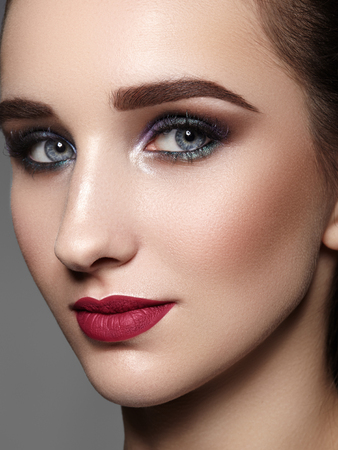 Photo for Beautiful Woman with Professional Makeup. Celebrate Style Eye Make-up, Perfect Eyebrows, Shine Skin. Bright Fashion Look. - Royalty Free Image