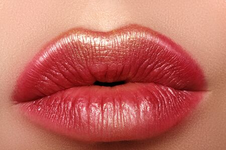Photo pour Macro close-up glamour fashion bright red lips make-up with gold glitter. Macro of woman's face part. Sexy lip makeup, luxury visage - image libre de droit