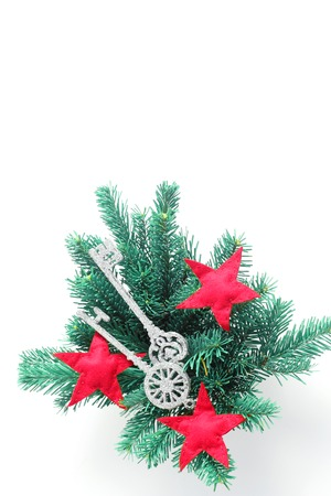 Foto de Christmas arrangement of branches of spruce and toys in the form of keys and stars. Flat lay, top view, vertical frame - Imagen libre de derechos