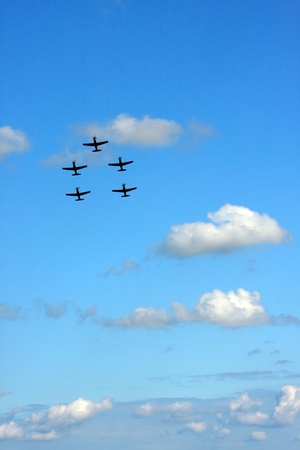 five airplanes in formation on airshow