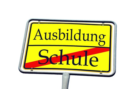 sign with the german words training school and school