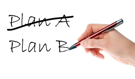 Hand with pen writing Plan A and Plan B