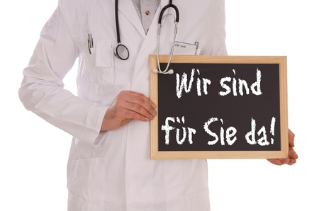 Doctor and sign with the german words We are there for them