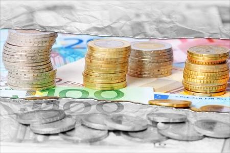 Euro coins and euro banknotes abstract
