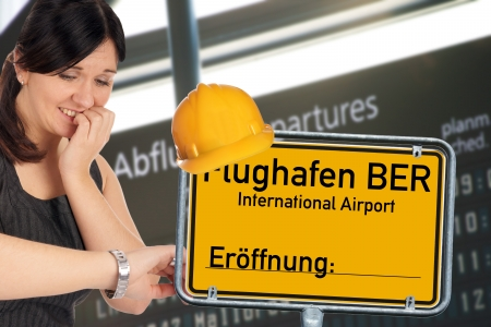 desperate woman and shield with the german words Berlin Brandenburg Airport