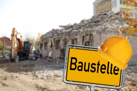Demolition House with shield and the German word construction site