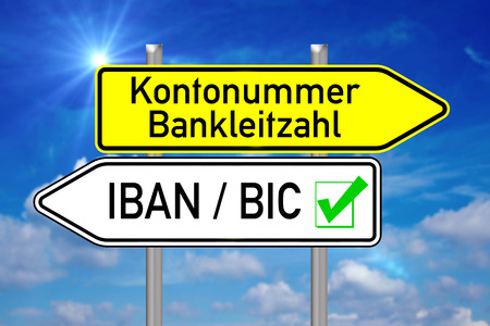 Signpost with the german words account number and IBAN BIC over blue sky