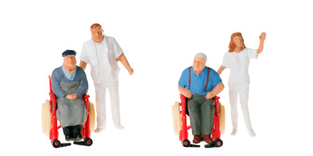 wheelchair user with nursing staff over a white background