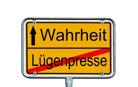 Sign with the german words truth and lies Press