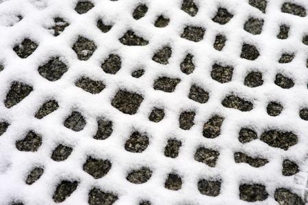 Snow lies on stones