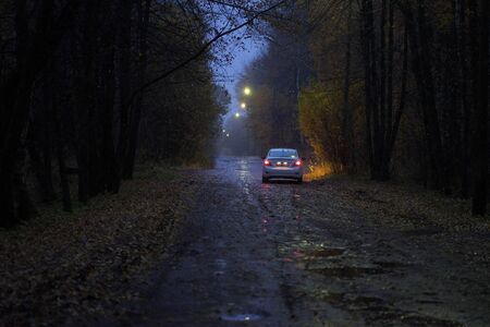 Photo for car with headlights on the autumn road - Royalty Free Image