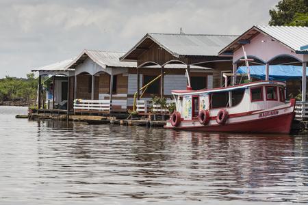 MANAUS, BRAZIL, OCTOBER 17: Typical wooden wooden houses on Rio Negro near Manaus, Amazonas State. Brazil 2013