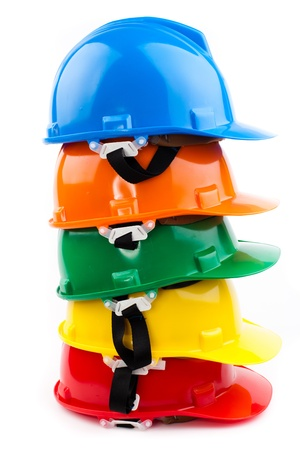 Photo pour colorful safety hardhats isolated on white - image libre de droit