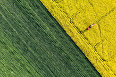 Photo pour aerial view of harvest fields with tractor in Poland - image libre de droit