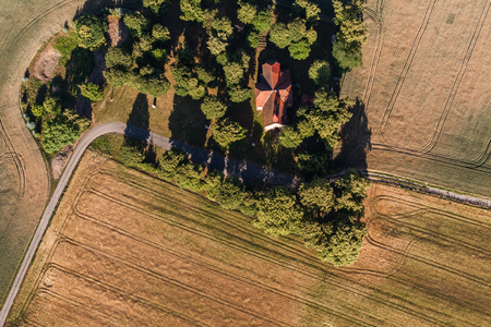 Photo pour aerial view of the  church and harvest fields in Poland - image libre de droit