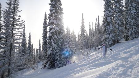 Photo pour Young woman Snowboarding on mountains at sun - image libre de droit