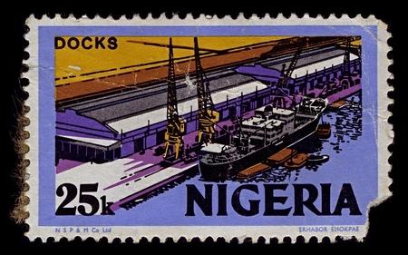 Nigeria-CIRCA 1973:A stamp printed in Nigeria shows image of port facilities, ñirca 1973.