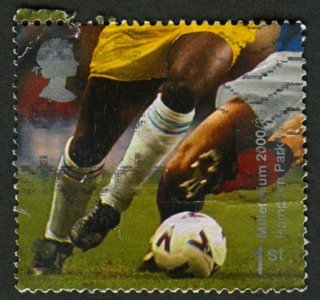 UK - CIRCA 2000: A stamp printed in UK shows image of the Football Players (Hampden Park, Glasgow), circa 2000.