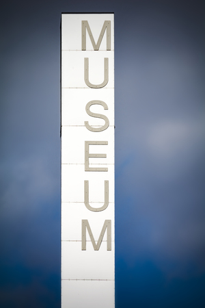 Tall museum sign outside cultural centre in Scandinavia