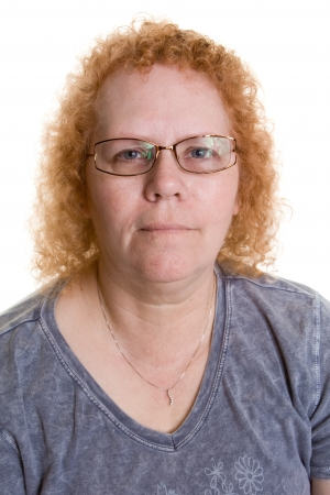 Close up of a heavy set middle aged woman with glasses