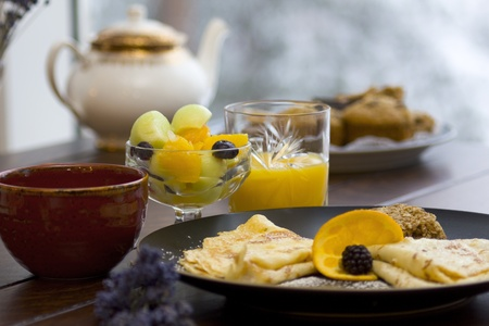 Fresh fruit breakfast served with tea and crepes