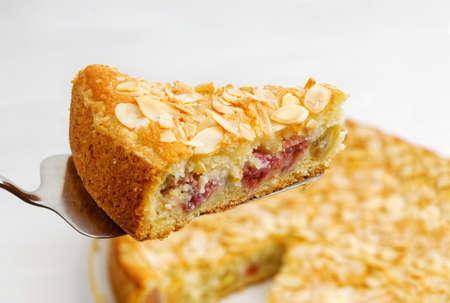 Photo pour Closrup piece of homemade gooseberry pie garnished with almond petals. Shallow focus. - image libre de droit