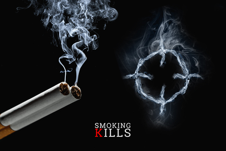 Photo for Cigarettes close-up on a black background, cigarette smoke, a target. Creative background. The concept of smoking kills, nicatine poisons, cancer from smoking, stop smoking. Copy space. - Royalty Free Image