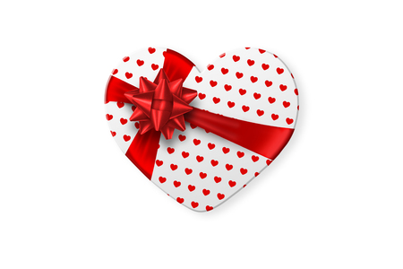 Foto de White gift box in the shape of a heart with a festive white bow isolated on white background. Romance, Valentine's Day, love. - Imagen libre de derechos