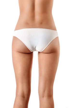 Photo for Perfect female body, buttocks close-up in white underwear, isolated on white background. The concept of beauty, plastic surgery. - Royalty Free Image