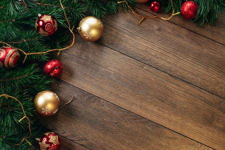 Photo pour Christmas ornaments and pine branches on a wooden table. Holidays christmas background. Copy space for text or design. View from above. - image libre de droit