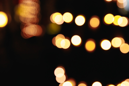 Photo for Blurred Christmas lights on a black background, bokeh. Light bokeh abstract. The concept of the new year 2018, holidays, vacation. - Royalty Free Image