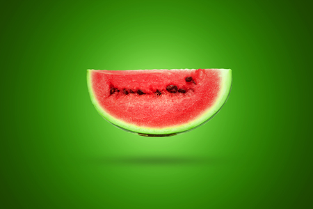 Photo for Slice of watermelon on a green background. Artistic background. - Royalty Free Image