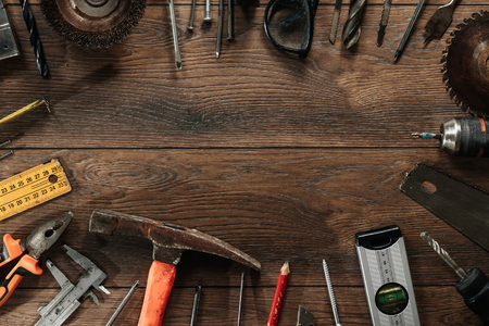 Photo for A construction tool on a brown wooden background. View from above. Picture background, screensaver. The concept of construction, repair, construction, production, design. Copy space. - Royalty Free Image