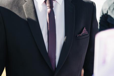 Photo pour A man in a blue suit straightens his sleeves - image libre de droit