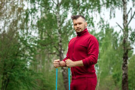 Photo pour Nordic walking, sticks, hands close-up. The concept of a healthy lifestyle, cardio training. Copyspace - image libre de droit