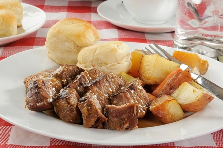A plate of pot roast with autumn vegetables