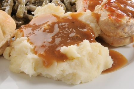 Close up of mashed potatoes with mushroom gravy