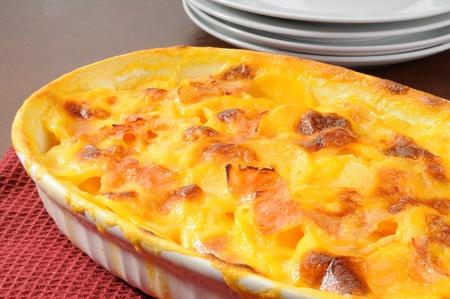 A casserole dish of au gratin potatoes with ham