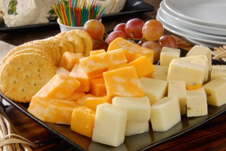 A plate of cheese and crackers on a party buffet table