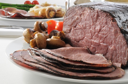 Thin sliced rare roast beef on the dinner table