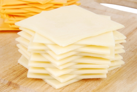 A stack of Swiss cheese slices