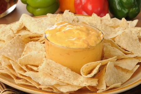 A platter of tortilla chips with salsa con queso