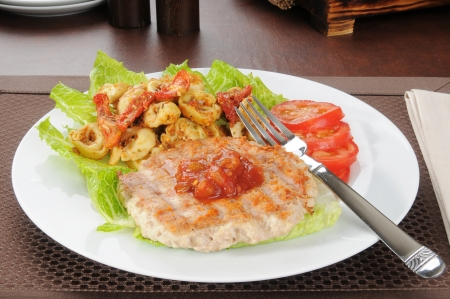 Healthy diet lunch with a chicken or turkey burger and tortellini